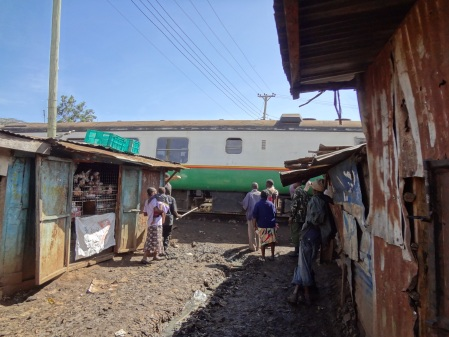 train goes through Kibera
